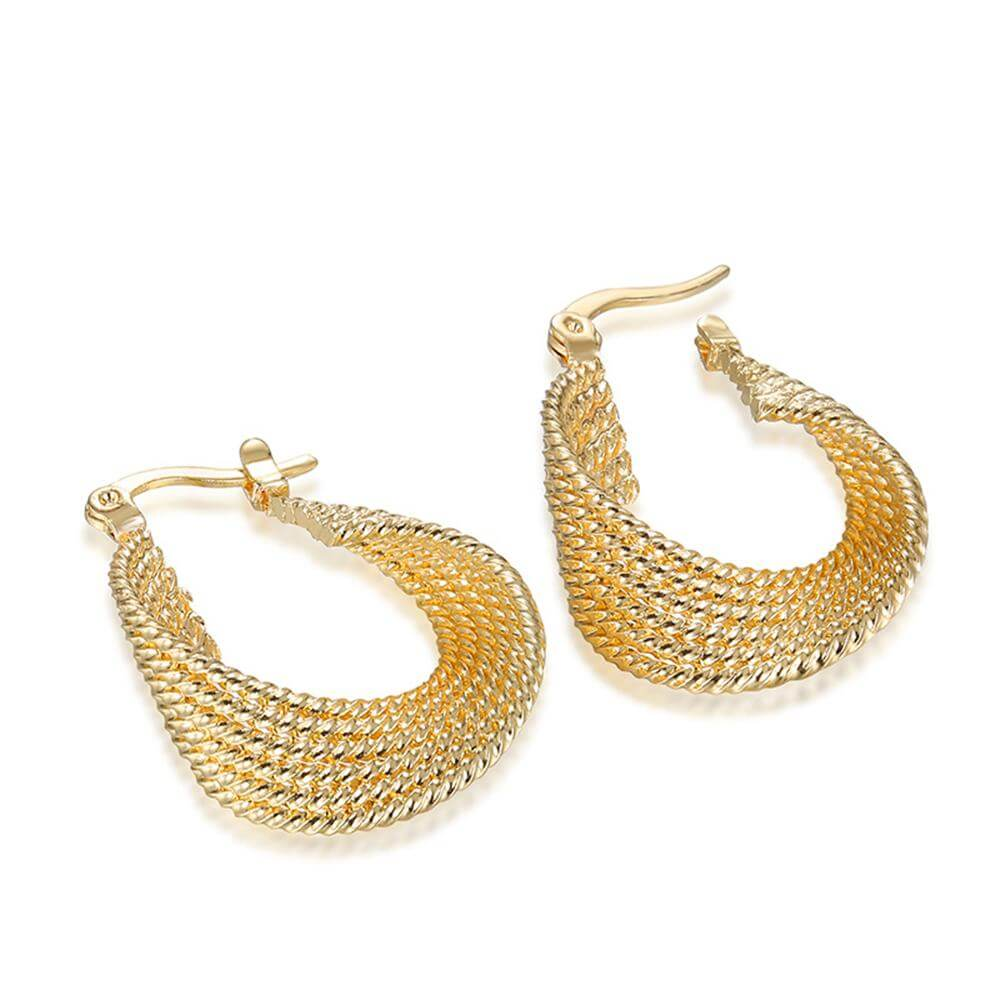 Twisted metal hoop earring gold and this gold tone brass pair offer ...