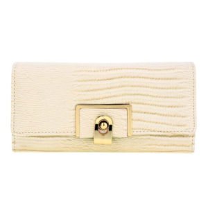 beige flap purse with gold metal work